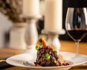 Braised Venison Shanks with Pomegranate and Quince - Cakebread Cellars