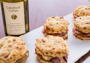 Carmody Cheese and Green Onion Biscuits with Smoked Ham and Red Pepper Jelly - Cakebread Cellars
