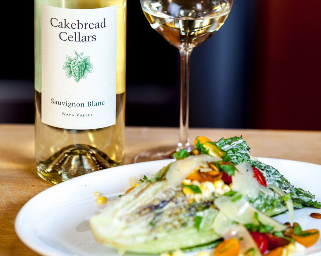 Grilled Hearts of Romaine with Jalapeño-Lime Dressing, Pepitas, Cherry Tomatoes and Sweet Corn - Cakebread Cellars