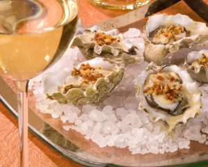 Hog Island Oysters with Andouille Sausage, Spinach and White Wine - Cakebread Cellars